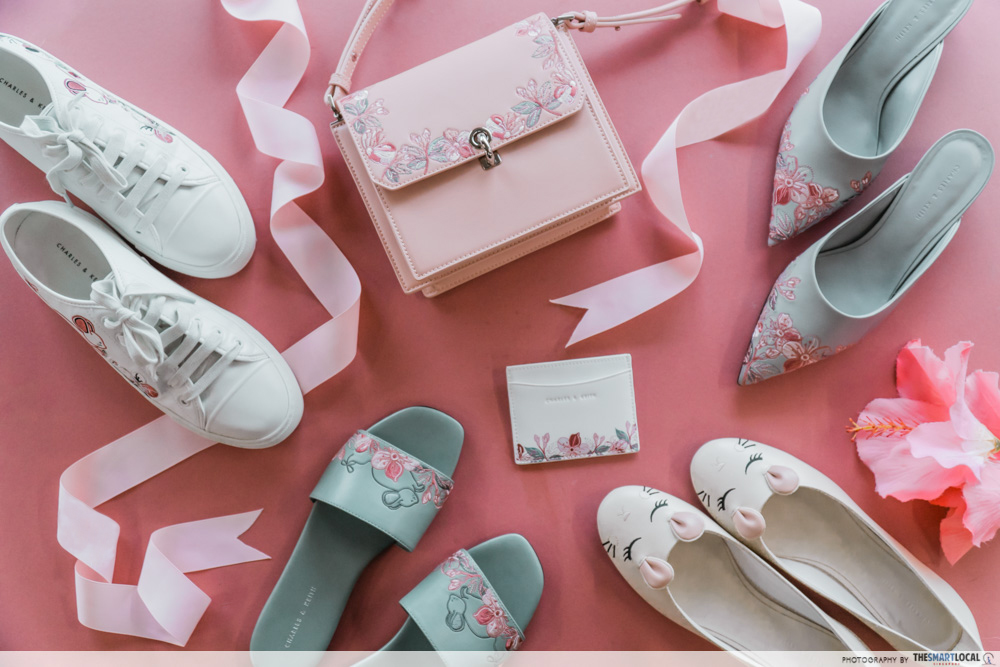 charles & keith cny collection - flat lay featuring embroidered sneakers, floral embroidered turn lock bag, mules, slide sandals, ballerina flats