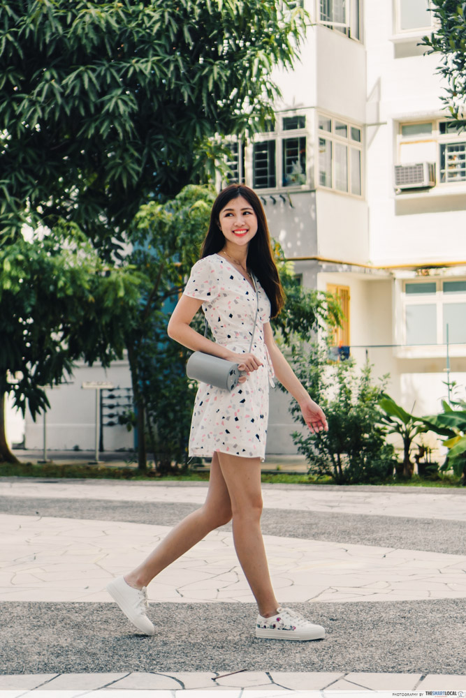 charles & keith cny collection - wearing dress with embroidered sneakers and rat zodiac cylindrical bag
