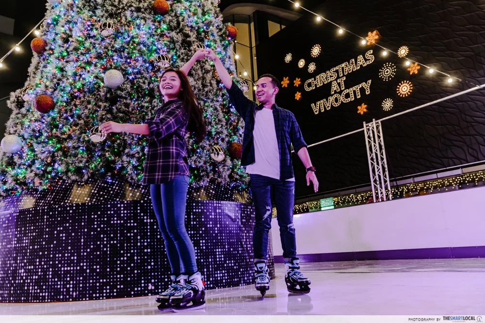 couple ice skating holding hands first date