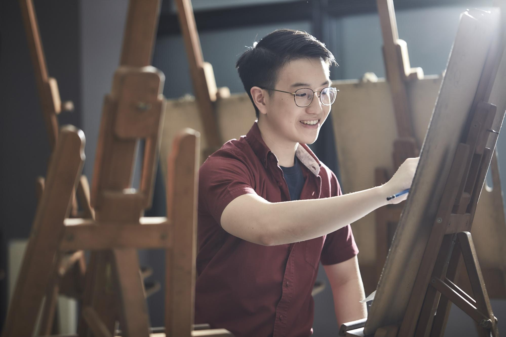polytechnic to local university - sketching or drawing on easel stand at nanyang poly