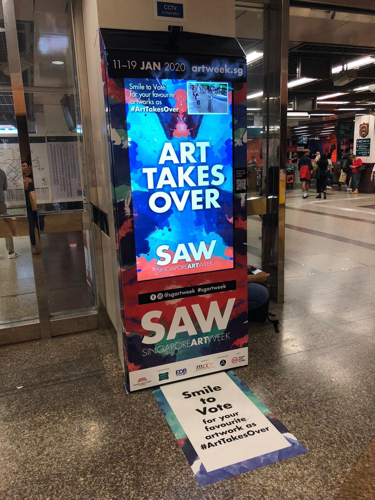 singapore art week 2020 - smile to vote at city hall mrt station