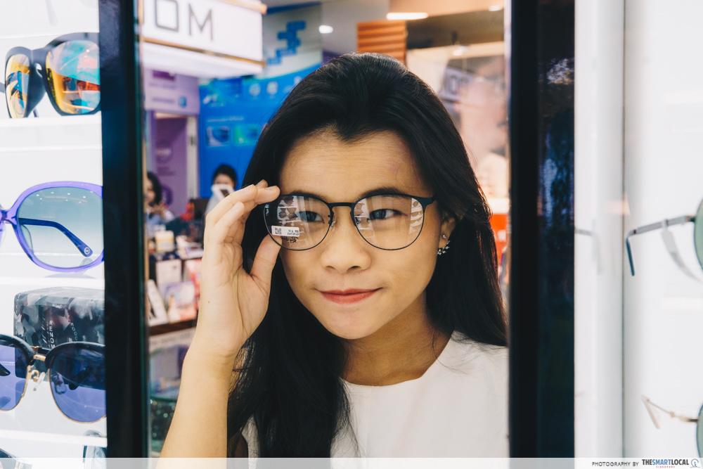 Girl trying on glasses