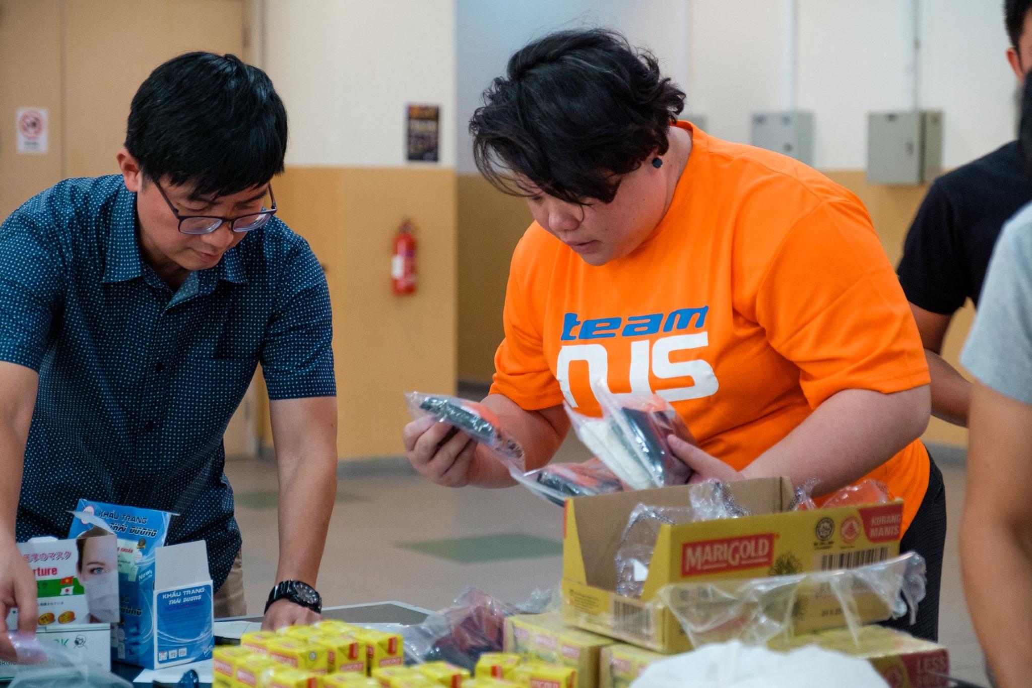 nus students packing welfare packs