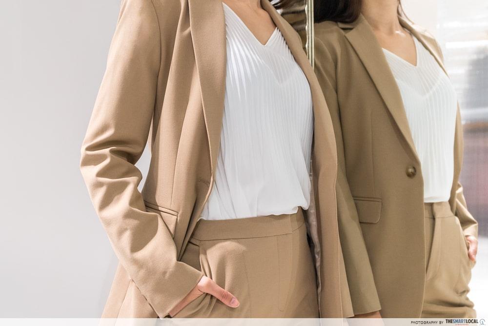 beige suit details layering
