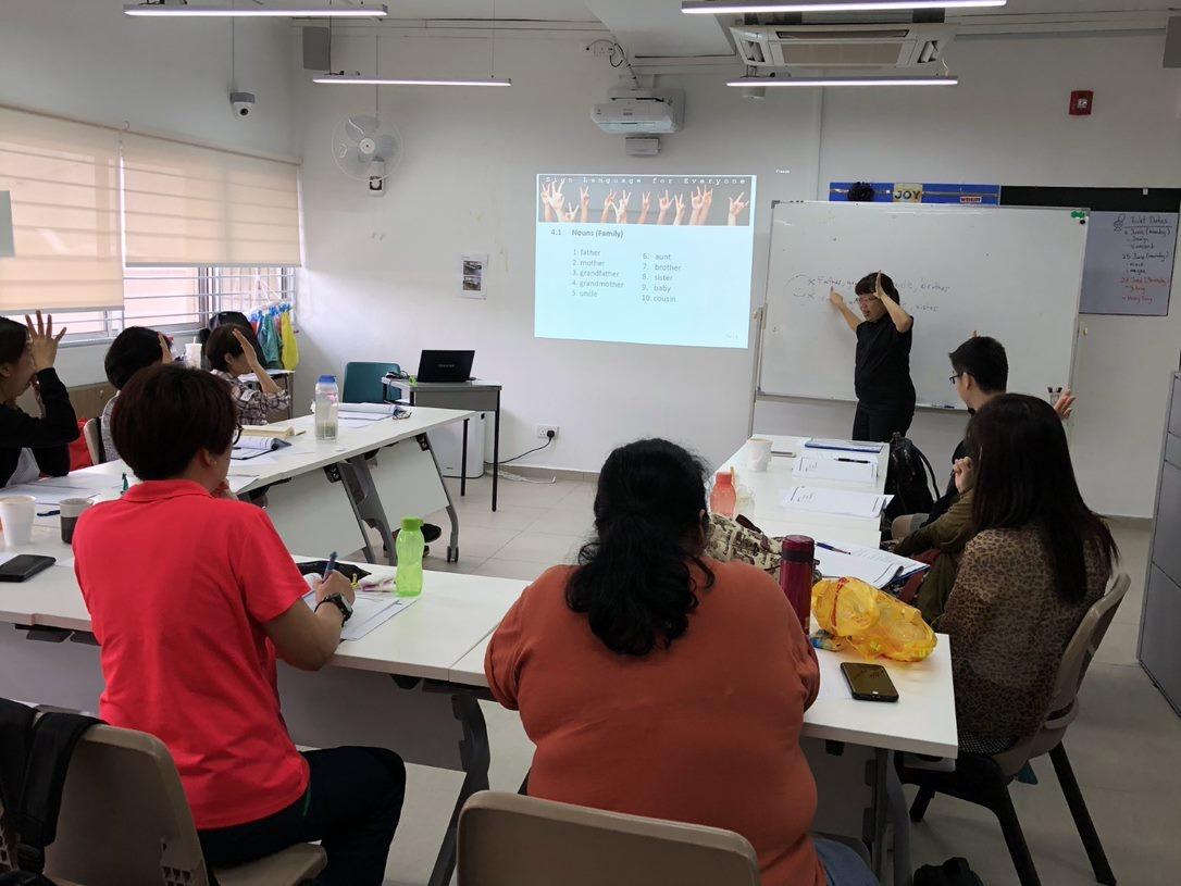 Volunteers in Singapore learn sign language in a course conducted by Touch Community Services