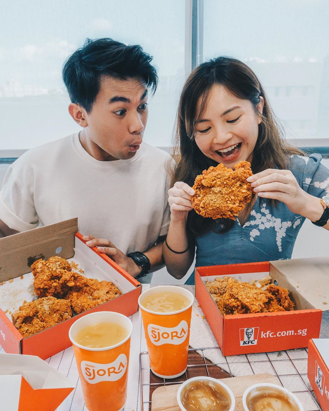 Couple eating fried chicken