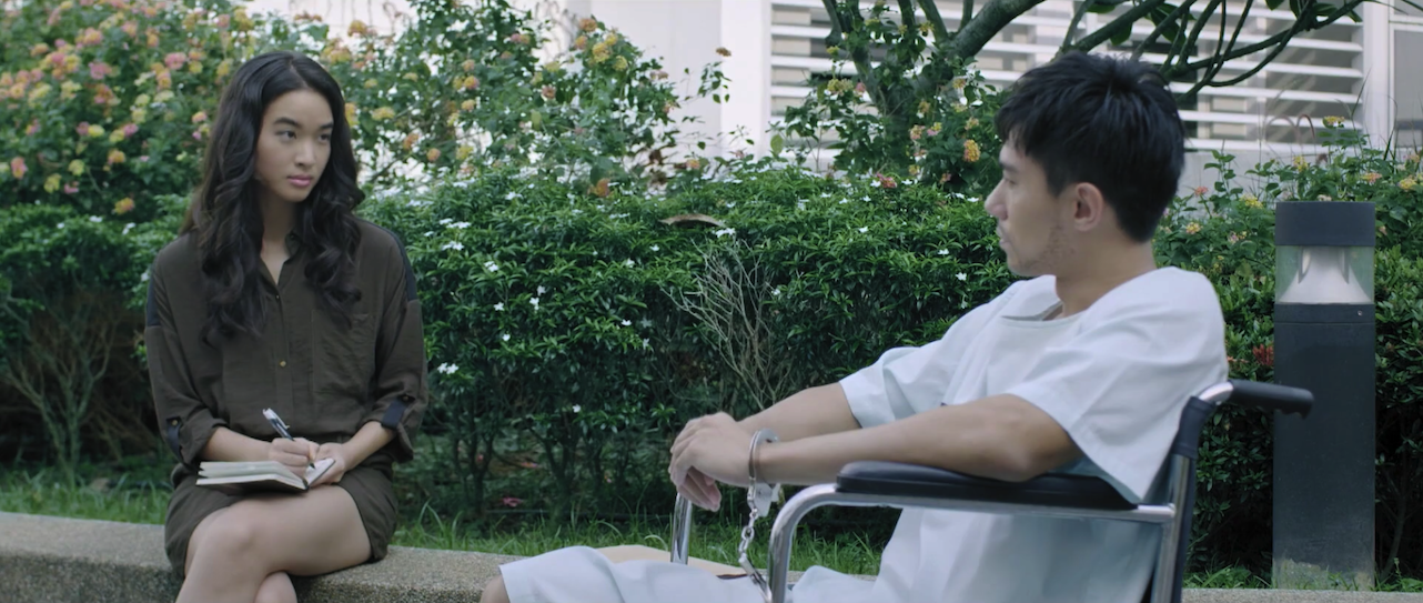 Derek speaks with his psychiatrist in a Singapore TV series, Derek.