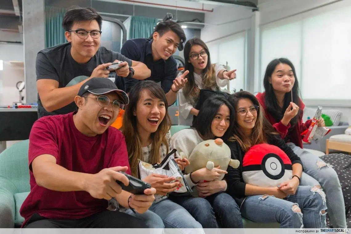 Gamers in Singapore - a group of people playing video games