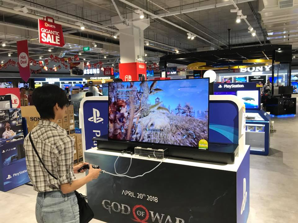 Gamers in Singapore - playing games on display TV