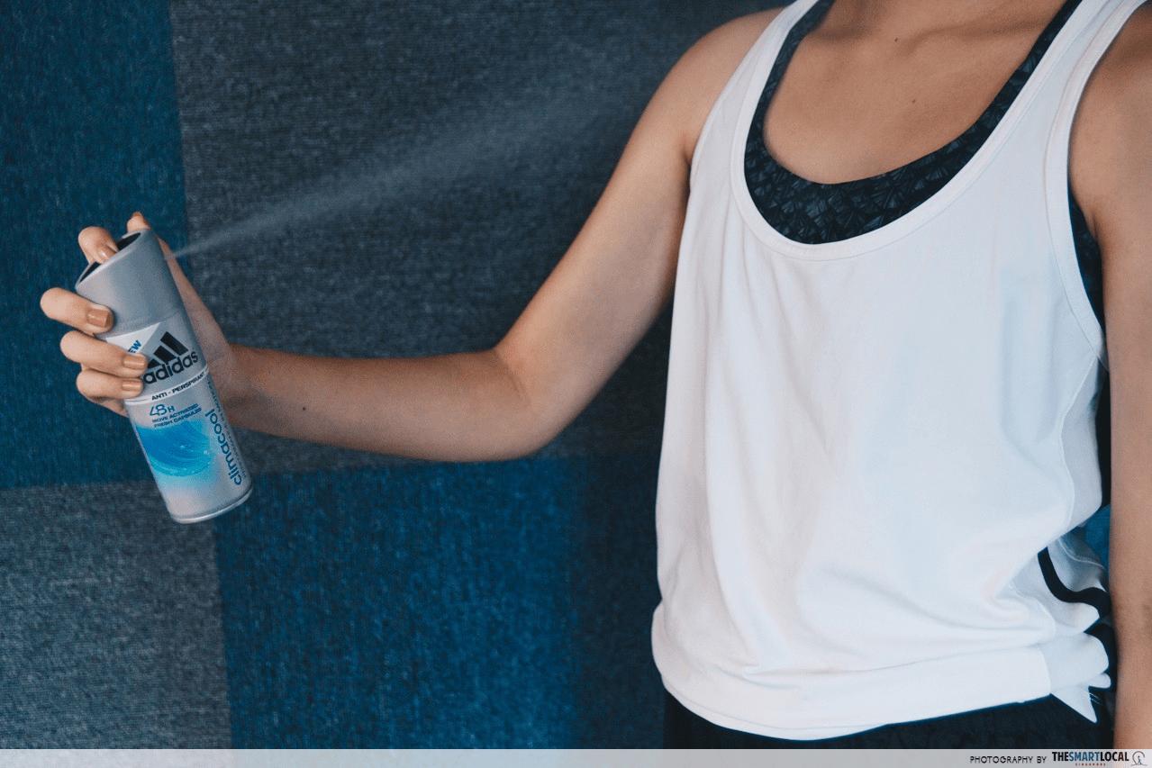 personal hygiene mistakes - spraying deodorant