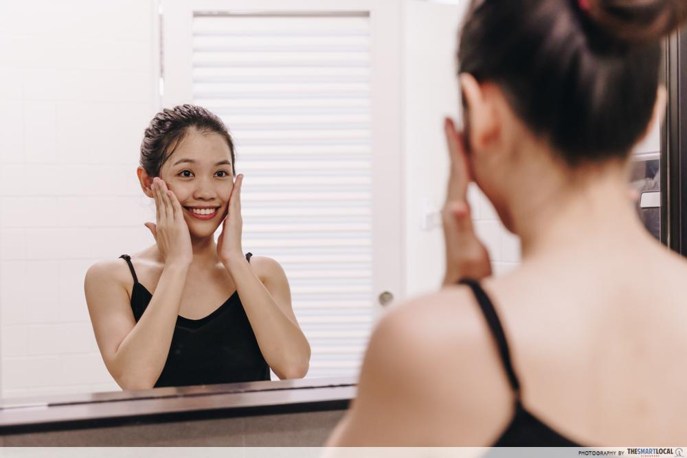 Applying skincare on wet face for korean glass skin