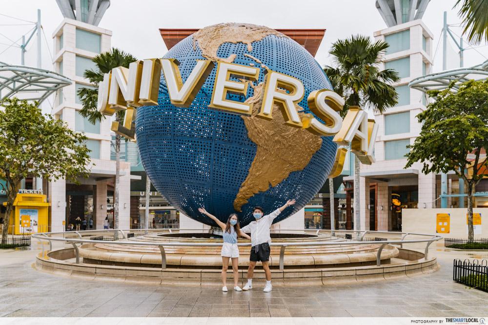 Posing in front of Resorts world sentosa universal globe