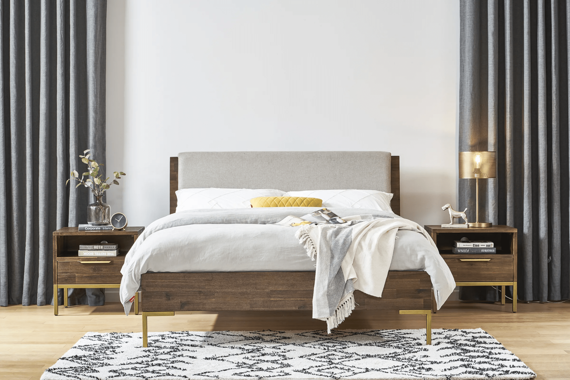 Castlery's Hudson bed with dark toned wood and gold trimmings