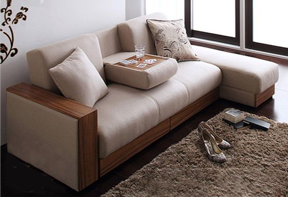 Sarai storage bed has a pull-down coffee table function