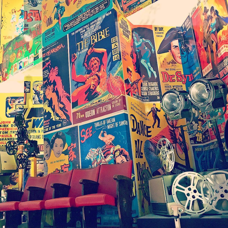 the cathay gallery - movie posters from the 70s and 80s adorn the walls
