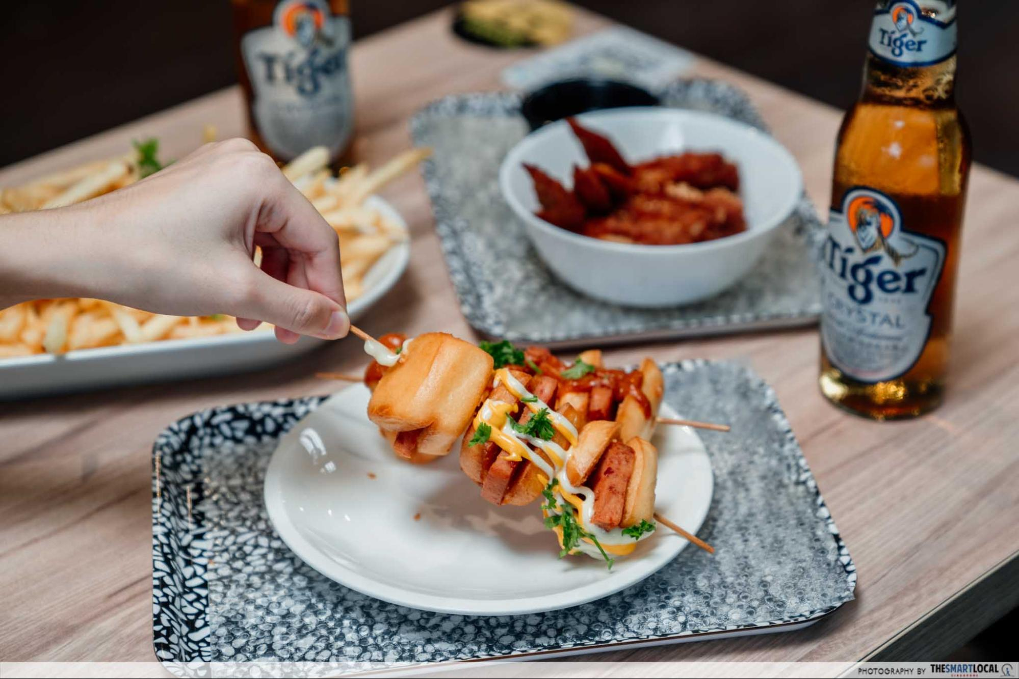 Mantou sticks with nachos and mayo and chilli crab sauce
