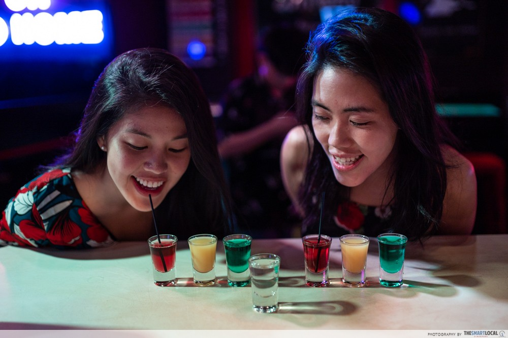 girls sipping shots, quit alcohol