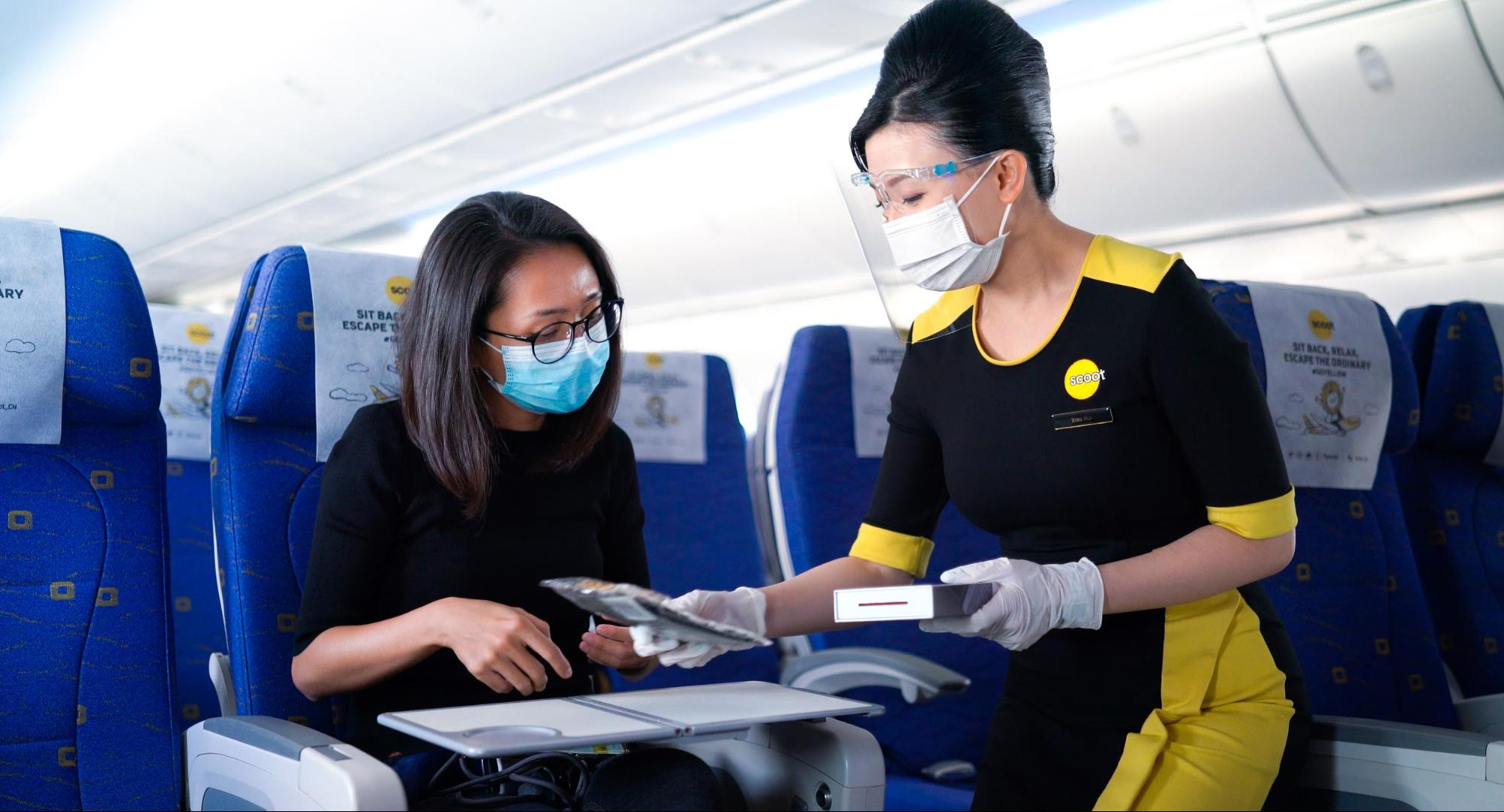 cabin crew delivering duty free purchases