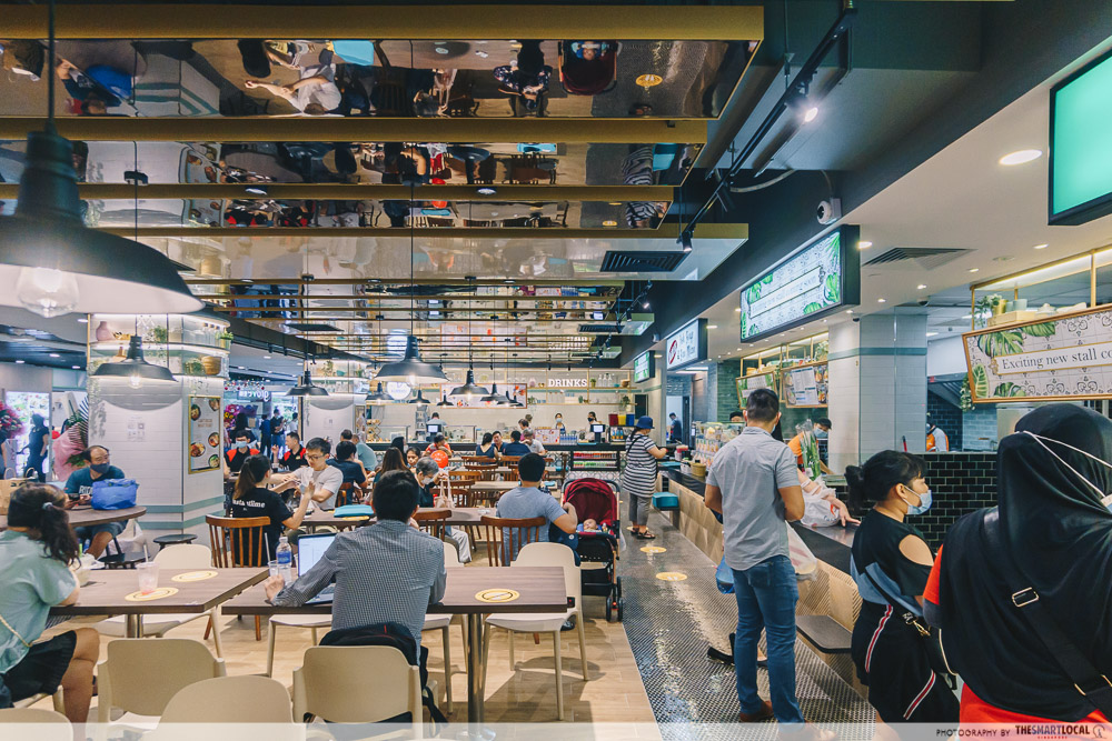 inside the cantine food court at canberra plaza singapore