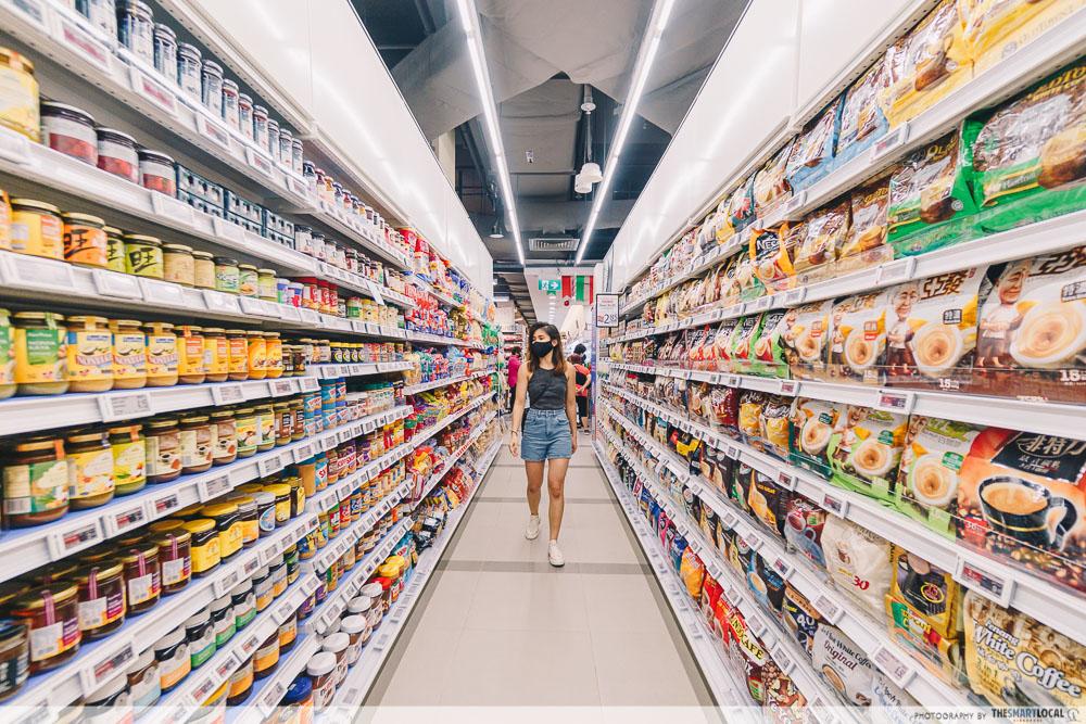 walking down an aisle of ntuc fairprice supermarket