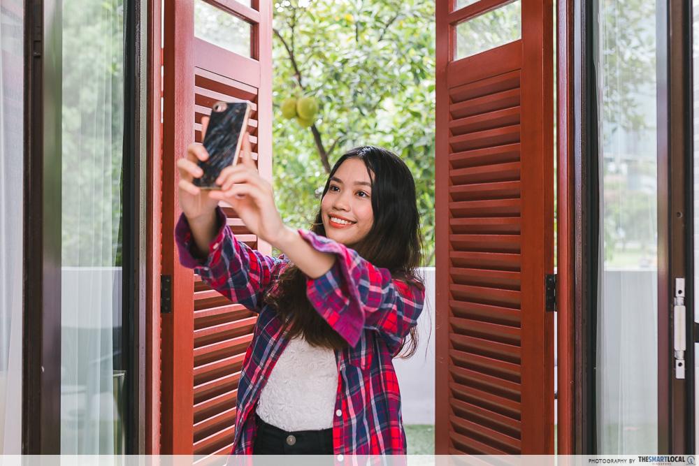Emily in Paris Selfie Scene in Singapore Hotel Vagabond