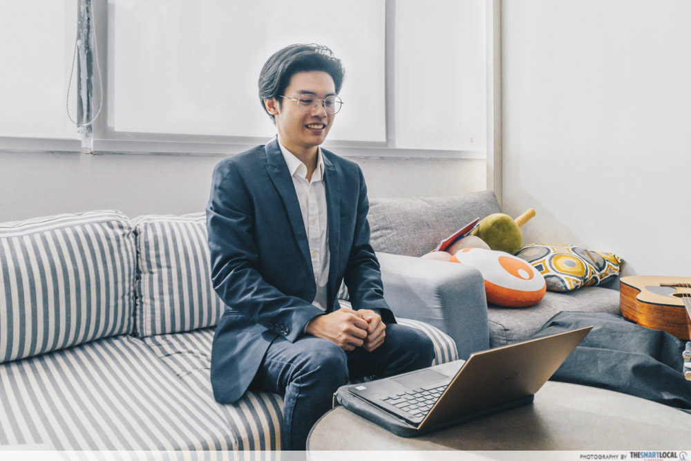 man dressed in a dapper suit presenting over a laptop, in-demand skills 2021