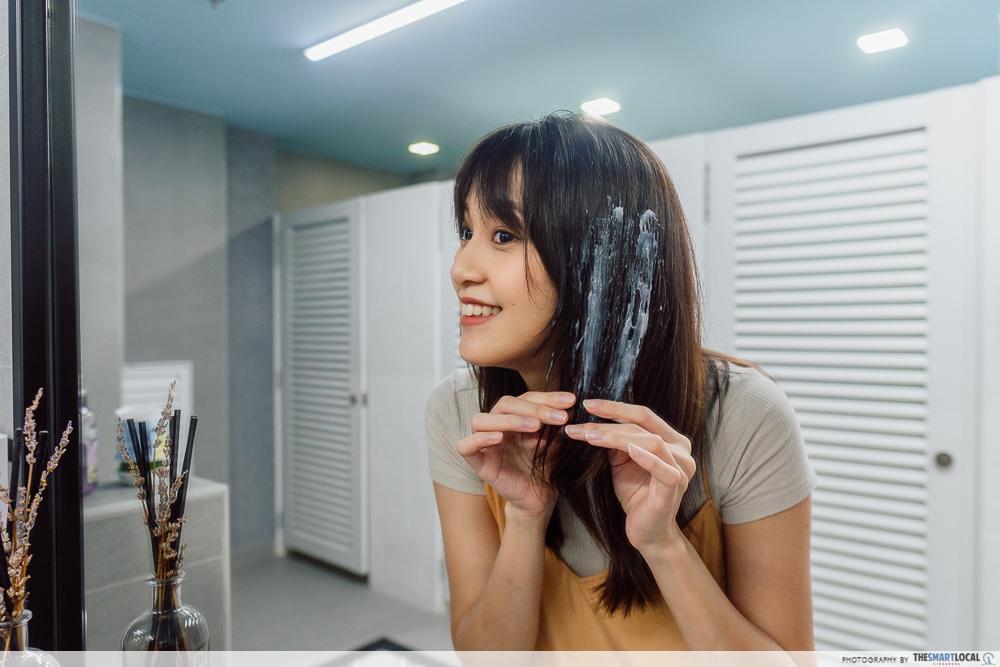 Applying hair mask onto hair