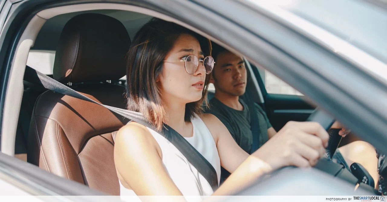 car accident singapore - worried woman driving car