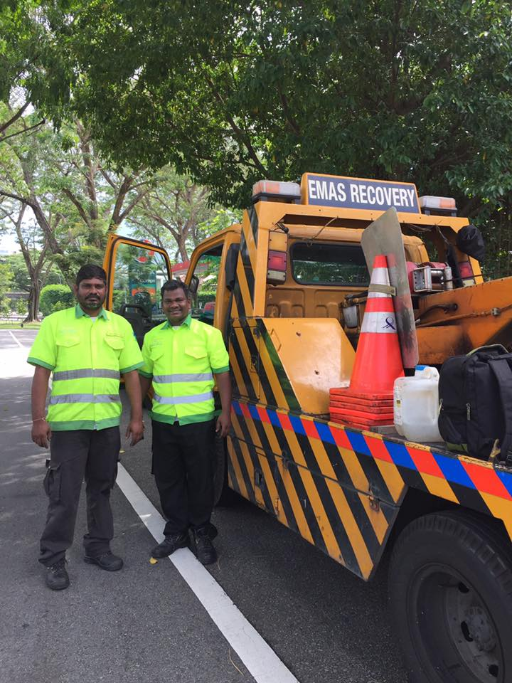 car accident singapore - EMAS Recovery staff with a tow truck