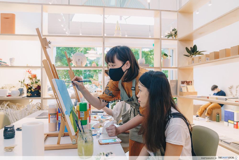 Staff guidance during art jamming workshop at Sage Artelier
