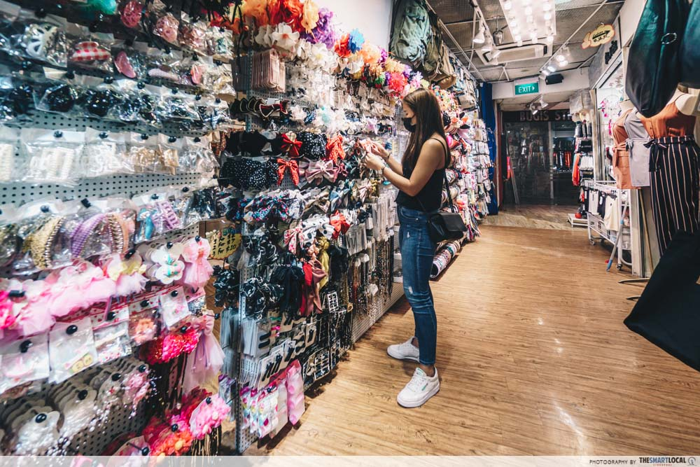 talent browsing a wall of accessories on level 2