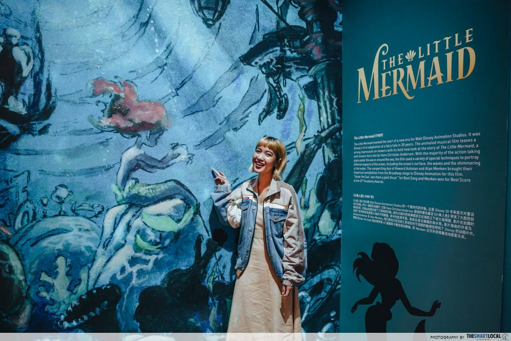 Image of woman standing in front of the Little Mermaid exhibit at ArtScience Museum
