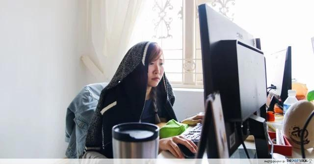 woman looking stressed while staring at computer screen, health mistakes when working from home