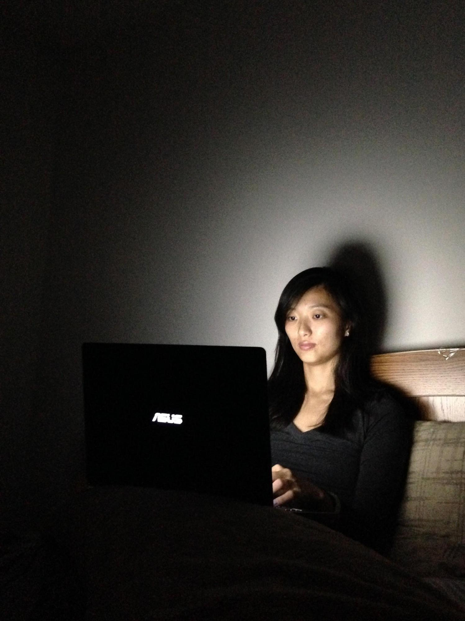 talent using laptop in the dark