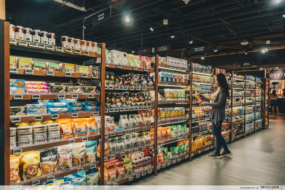 woman browsing stocked shelves in a supermarket