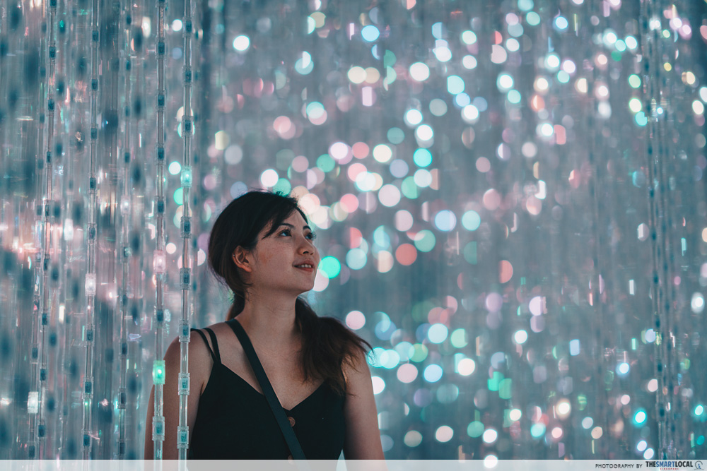 Image of woman looking at lights at the Future World exhibit