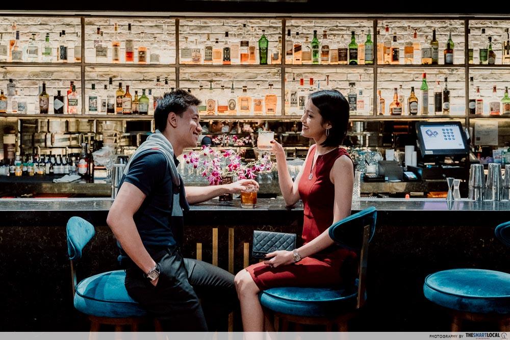 girl and guy at bar