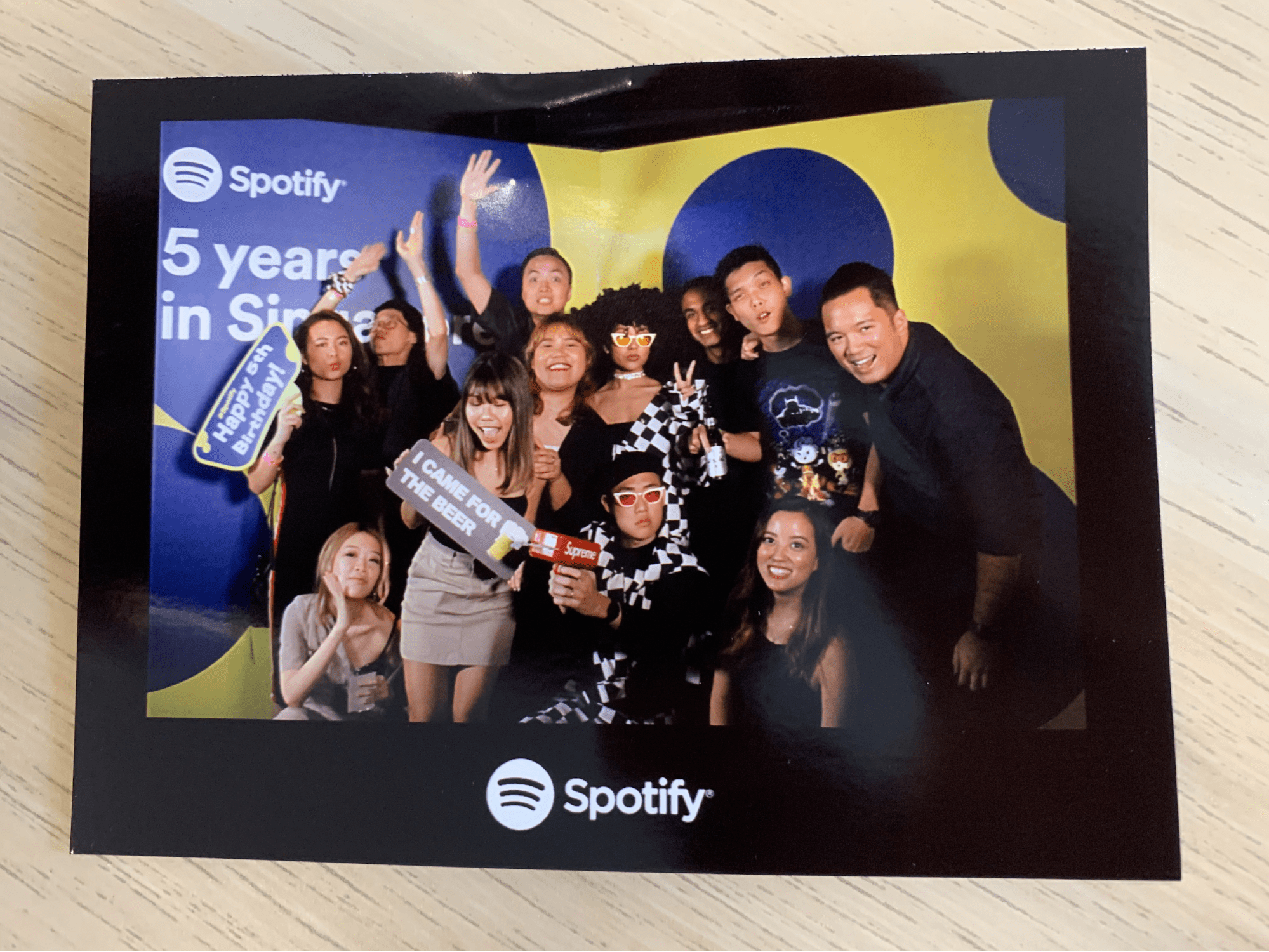 nikki homaili with her colleagues at spotify's 5th anniversary event
