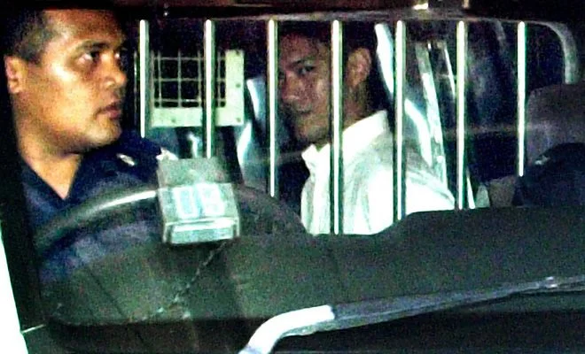 the convicted anthony ler within a police vehicle