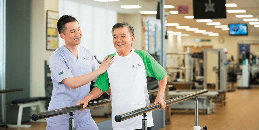 Physiotherapist helping an elderly man