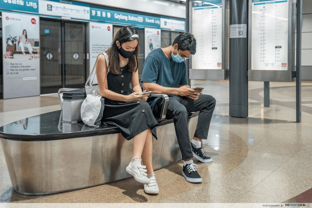 Using phone at MRT station Singaporeans