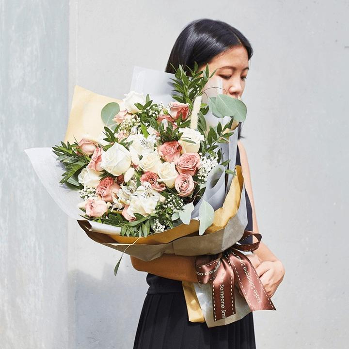 Woman Holding Far East Flora Bouquet