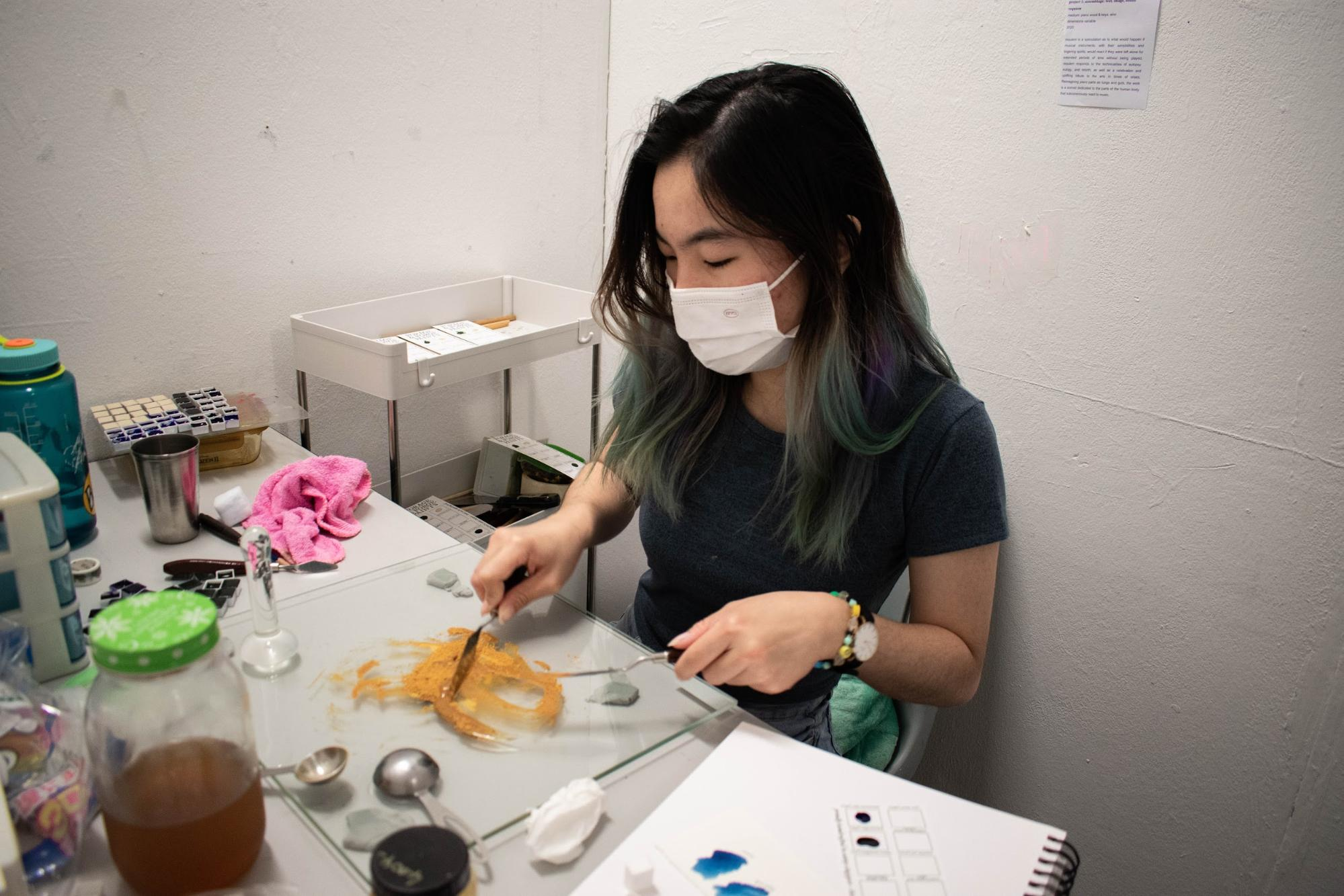 annjee teo working on her paints for forage and forge paints