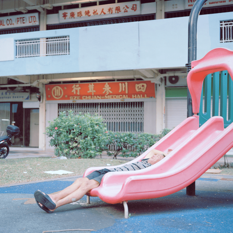 Nguan Man Sitting On A Slide