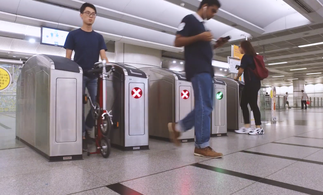 CarryMe passing through MRT gantry - best foldable bicycles in singapore