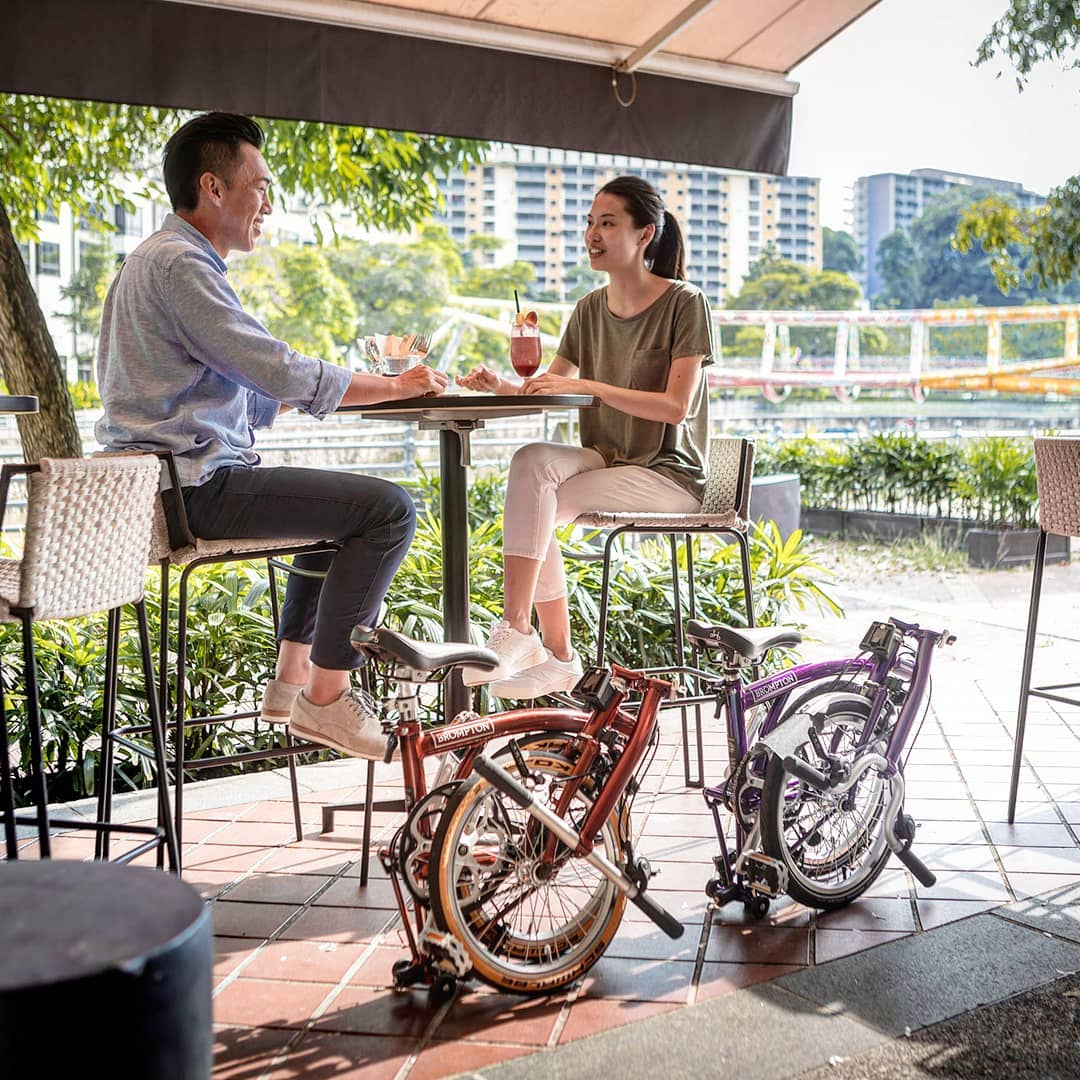 brompton bicycles can fold small enough to fit under tables