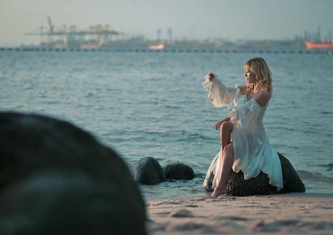 Girl on the rocks at Punggol Beach