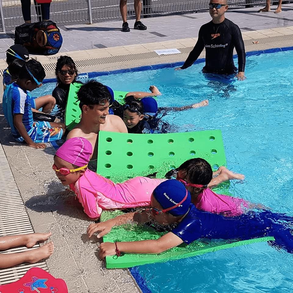 Swimming-Lessons-In-Singapore - swim schooling