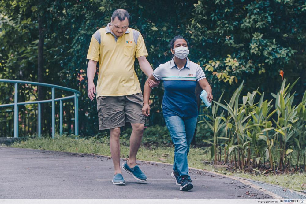outdoor walk adult with autism caregiving