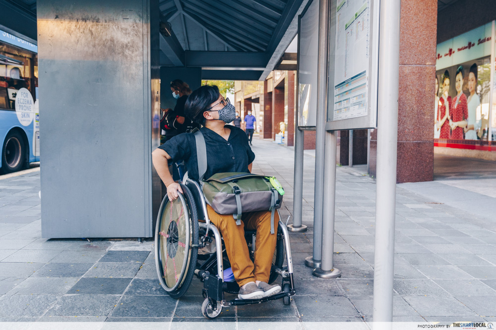 wheelchair user at bus stop